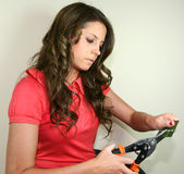 No Credit Please. A young woman cuts up her credit card stock photo