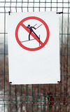 No cross-country skiing allowed sign. On metallic green fence Stock Photos