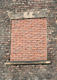 No curtains needed. Old brick building has has the window recently bricked up stock photo