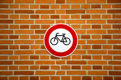 No cycling sign on brick wall Stock Image