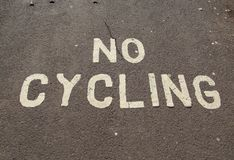 A no cycling sign painted on the pavement on the Esplanade in Sidmouth, Devon royalty free stock image