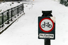 No Cycling Sign in a Park, Snowy Day Stock Image