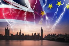 No Deal BREXIT conceptual image of lightning over London and UK and EU flags symbolising destruction of agreement. No Deal BREXIT concept image of lightning over royalty free stock image