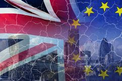 No Deal Brexit conceptual image of cracks over image of London with UK and EU flags in image royalty free stock image