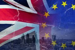 No Deal Brexit conceptual image of cracks over image of London with UK and EU flags in image. No Deal Brexit concept image of cracks over image of London with UK stock photos