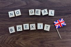 No Deal Brexit with Union Jack Flag. No Deal Brexit and Union Jack Flag on a dark wood background royalty free stock photos
