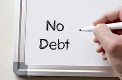No debt written on whiteboard. Human hand writing no debt on whiteboard Stock Photos
