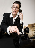 No Dial Tone. Retro office woman trying to make a call on a vintage phone royalty free stock photos