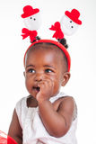 No diamonds up there. A 8 month old baby dressed to explore Christmas Stock Images