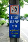 No digging sign in Bangkok, Thailand. Road digging is the main cause of traffic jams. Translation Text is `If you see someone digging, Please Call 1555 royalty free stock photography