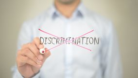 No Discrimination,, Man writing on transparent screen. High quality stock photography