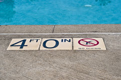 No diving with 4 ft water. No diving with 4 ft pool water depth Royalty Free Stock Images