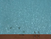 No Diving. View from above of the edge of a swimming pool with No Diving written on the ground Stock Images