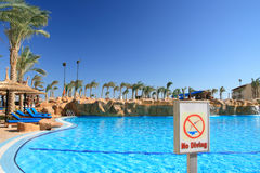 No diving. Waterpool in egyptian hotel. notice no diving Royalty Free Stock Photo