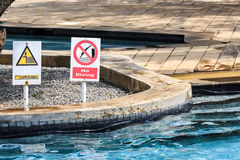 No diving and depth signs in swimmimg pool Stock Photos