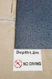 No diving and jumping sign Stock Image