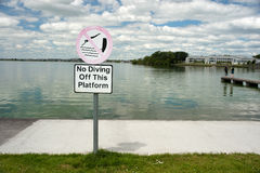 No diving sign by lake edge Royalty Free Stock Photos