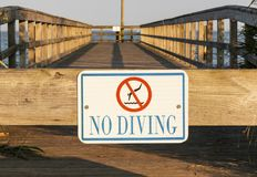 No Diving Sign on a pier royalty free stock photo