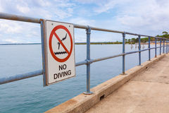 No Diving sign on a pier railing Royalty Free Stock Images