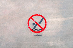 No diving warning sign at the poolside . Stock Photography