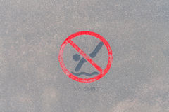 No diving warning sign at the poolside . Stock Image