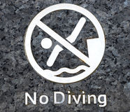 No diving warning at swimming pool Royalty Free Stock Photos
