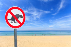 No dog pooping sign on the beach Royalty Free Stock Image