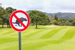No dog pooping sign golf course Stock Photography
