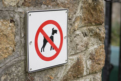 No dog. Sign on wall stock images