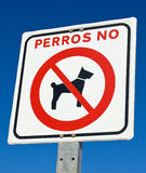 No Dogs. A Spanish sign indicating Perros No, meaning No Dogs Royalty Free Stock Images
