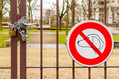 No dogs allowed sign and locked park gate with pad lock Royalty Free Stock Photo
