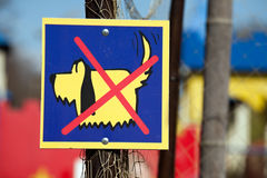 No Dogs sign. With funny little dog and red cross over it Royalty Free Stock Photo