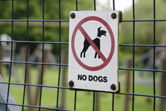No dogs sign. A sign on a fence warning of no dogs allowed Stock Images