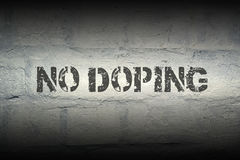 No doping GR. No doping black stencil print on the grunge brick wall with gradient effect; specially designed font is used Stock Photos