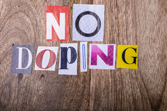 No doping. Text made with newspaper letters on wood Stock Image