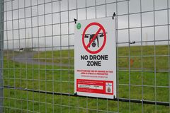 Free No Drone Zone Sign On Security Fence Stock Photography - 164137242
