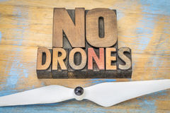 No drones sign or banner in wood type. No drones sign or banner - word abstract in vintage letterpress wood type blocks with a drone propeller royalty free stock images