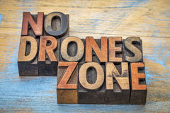 No drones zone sign or banner in wood type. No drones zone sign or banner - word abstract in vintage letterpress wood type blocks stock photos