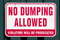 No Dumping Allowed. No dumping sign on a metal wall Stock Images