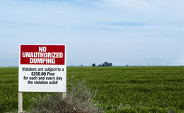 No Dumping sign in field Royalty Free Stock Photography