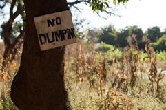 No Dumping Sign and Vegetation, Livingstone, Zambia.  royalty free stock image