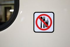 No eating sign pictogram on the white metal wall. By the bus window Stock Photography