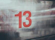 No 13 en fondo del metal Imágenes de archivo libres de regalías
