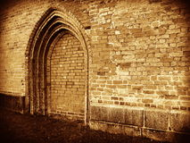 No entrance - Closed gate. Entrance blocked. Old side wall door portal at the romanic cathedral in Ratzeburg, Germany. Sepia Royalty Free Stock Image