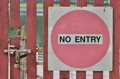 No Entry. A frontal photo taken on a no entry signboard before a reservoir Royalty Free Stock Photos