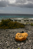 No Entry. Yellow stone sign at Bonaire marine reserve stock images