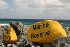 No Entry Marine Reserve. Two stones with messages No Entry and Marine Reserve on tropical island of Bonaire in the Caribbean royalty free stock image