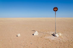No entry or passage prohibited sign in the middle of the Namib Desert  in front of blue sky. And desert vista Royalty Free Stock Image