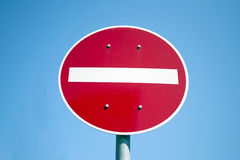 No entry. Red and white no entry road sign against blue sky Royalty Free Stock Photography