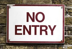No entry red and white sign on brick wall. No entry red and white gritty sign on brick wall Royalty Free Stock Photos